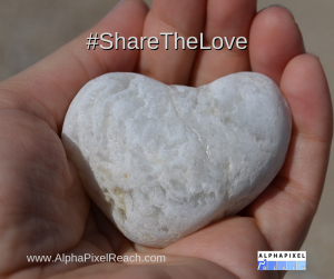 Share the love 2019 image - white rock heart in the palm of a hanc