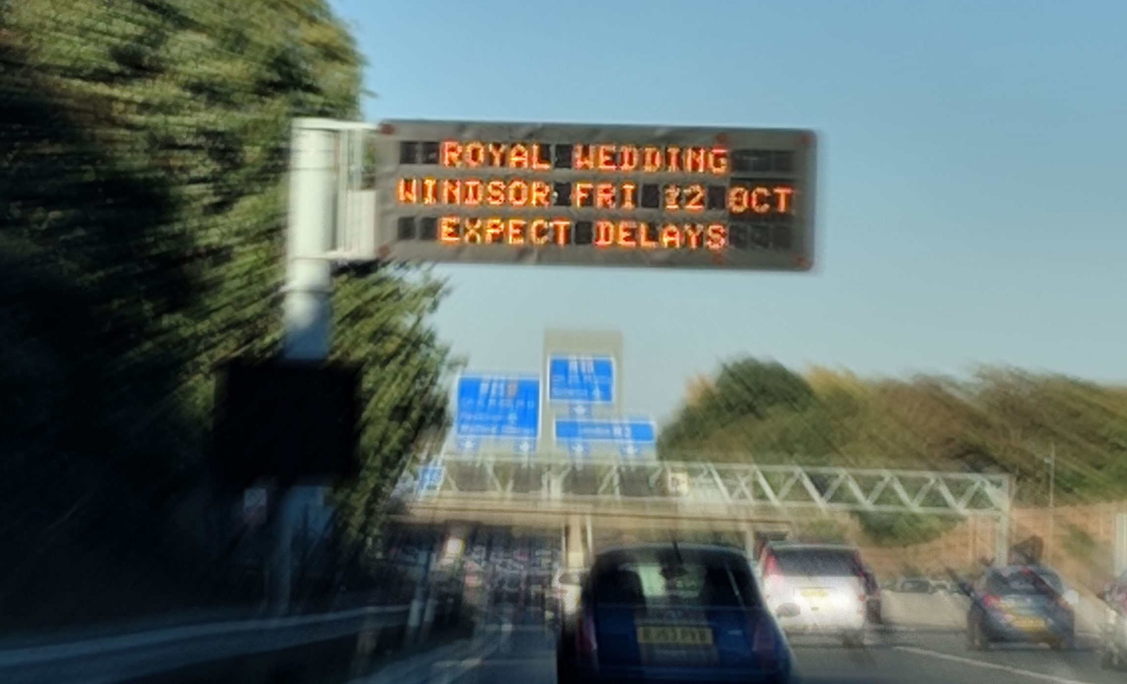 Overhead traffic sign warning of delays due to royal wedding