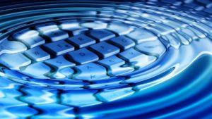 keyboard underneath rippling water