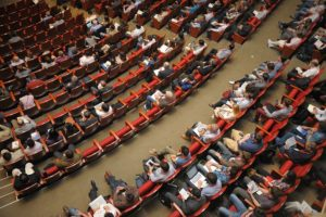 audience in red chairs