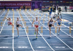 women athletes in hurdle race